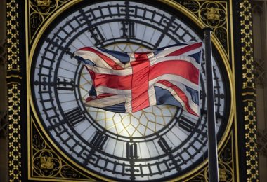 """The Union flag is seen flapping in the wind in front of one of the faces of the Great Clock atop the landmark Elizabeth Tower that houses Big Ben at the Houses of Parliament where lawmakers are expected to vote in favour of joining air strikes against Islamic State (IS) militants in central London on 26 September, 2014. British Prime Minister David Cameron warned that military action against Islamic State (IS) militants could last for """"years"""" Friday as he urged lawmakers to back joining US-led air strikes in Iraq but not in Syria. Kicking off a crunch debate in the House of Commons, Cameron said the """"hallmarks"""" of the campaign would be """"patience and persistence, not shock and awe"""". AFP PHOTO / JUSTIN TALLIS        (Photo credit should read JUSTIN TALLIS/AFP/Getty Images)"""